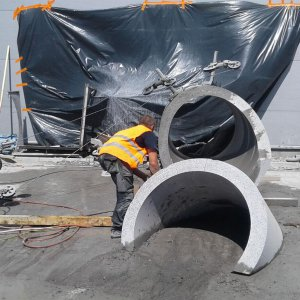 Cutting concrete and reinforced concrete with diamond wire saws